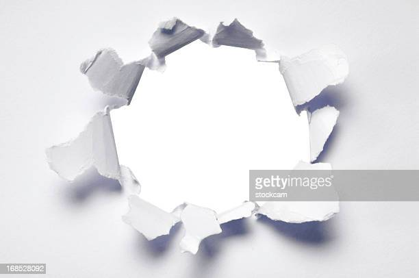 Ripped hole in blank paper