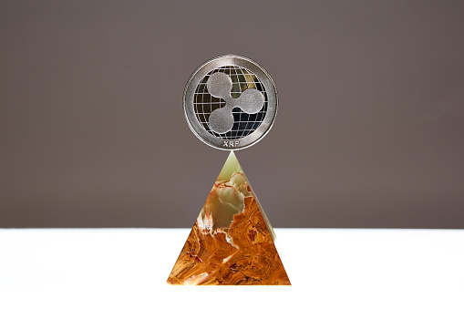 Ripple Coin floating above an Onyx Stone Pyramid - gettyimageskorea