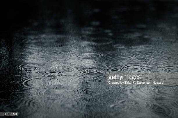 ripples of raindrops in puddle - puddle stock pictures, royalty-free photos & images
