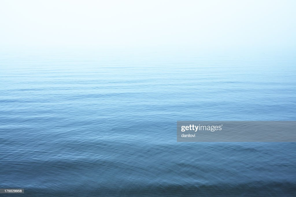 Ripples on blue water surface : Stock Photo