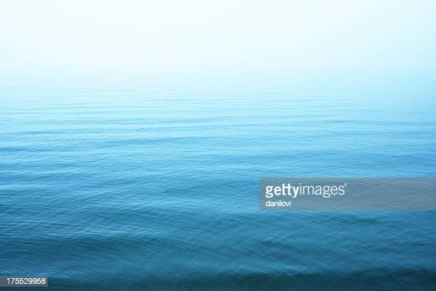 ripples on blue water surface - kalmte stockfoto's en -beelden