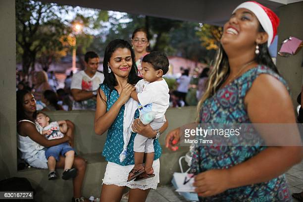 Riquelme Kauan who was born with microcephaly is held by his mother Avila during a Christmas party on December 17 2016 in Recife Brazil The party was...