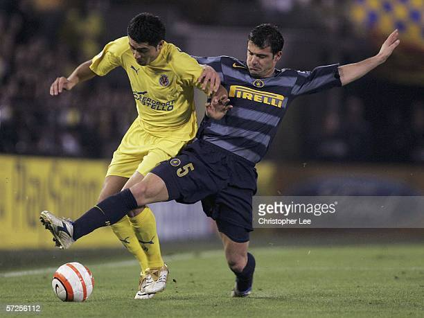 Riquelme of Villarreal is tackled by Dejan Stankovic of Inter Milan during the Champions League Quarter Final Second Leg match between Villarreal and...