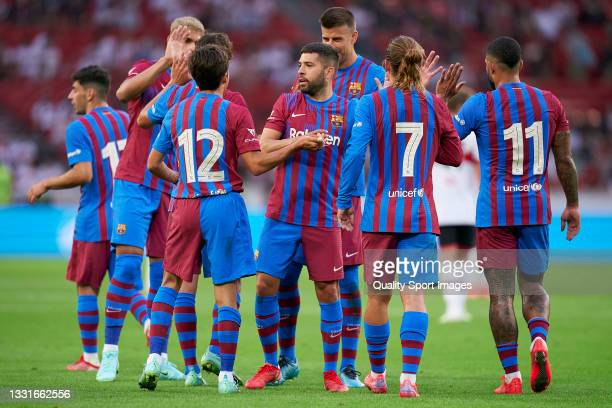 Riqui Puig of Barcelona celebrates after scoring his team's third goal with his teammates during a pre-season friendly match between VfB Stuttgart...