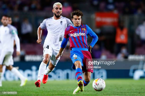 Riqui Puig of FC Barcelona pass the ball during the La Liga Santander match between FC Barcelona and Granada CF at Camp Nou on September 20, 2021 in...