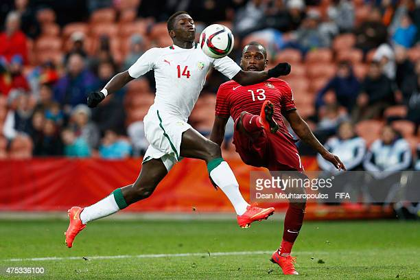 Riquicho of Portugal and Moussa Kone of Senegal battle for the ball during the FIFA U20 World Cup New Zealand 2015 Group C match between Portugal and...