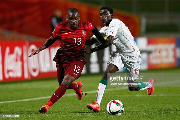Riquicho of Portugal and Moussa Wague of Senegal battle for the ball during the FIFA U20 World Cup New Zealand 2015 Group C match between Portugal...