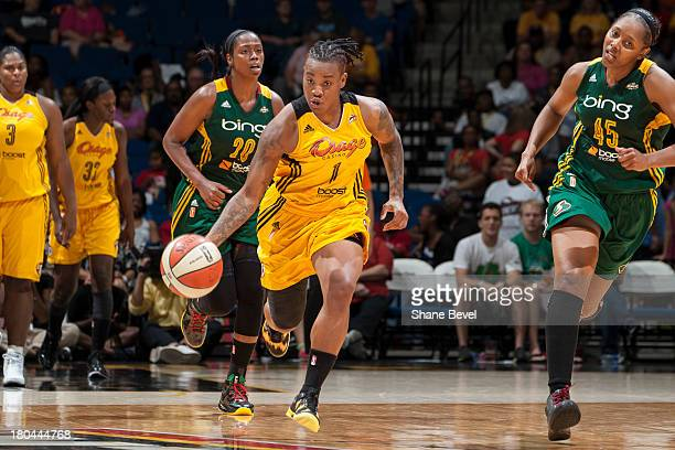 Riquna Williams of the Tulsa Shock drives downcourt against Camille Little and Noelle Quinn on a breakaway during the WNBA game on September 12 2013...