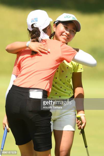 Riri Sadoyama of Japan and Grace Kim of Australia hug on the 9th hole during the third round of the 2017 TOYOTA Junior Golf World Cup at the Chukyo...