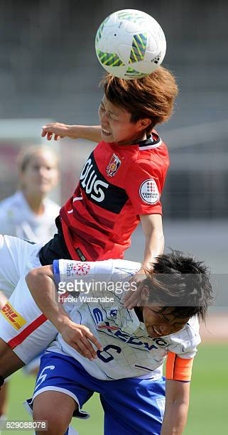 Risa Ikadai of Urawa Red Diamonds Ladies and Maiko Nasu of Iga FC Kunoichi compete for the ball during the Nadeshiko League match between Urawa Red...