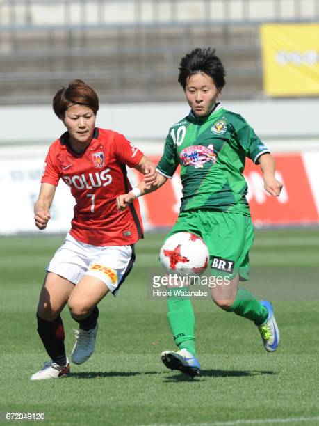 Risa Ikadai of Urawa Red Diamonds Ladies and Yuka Momiki of NTV Beleza compete for the ball during the Nadeshiko League match between Diamonds Ladies...