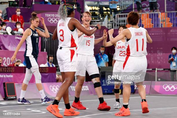 Risa Nishioka of Team Japan celebrates victory with team mates after defeating Team France during the Women's Pool Round match between Japan and...