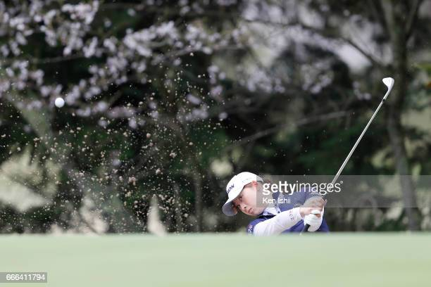 Risa Ogusu hits out of a bunker on the 9th hole during the final round of the Hanasaka Ladies Yanmar Golf Tournament at the Biwako Country Club on...
