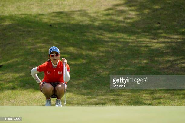 Risa Ogusu of Japan prepares to putt on the 6th green during the final round of the Shizu Hills Ladies Mori Building Cup at Shizu Hills Country Club...
