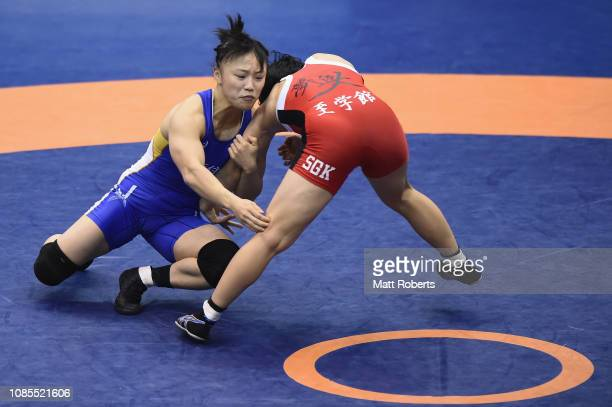 Risa Otaka competes against Eri Tosaka during the women's 50kg Freestyle match on day three of the Emperor's Cup All Japan Wrestling Championships at...