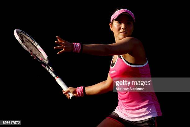 Risa Ozaki of Japan cplays Louis Chirico during the Miami Open at the Crandon Park Tennis Center on March 22 2017 in Key Biscayne Florida