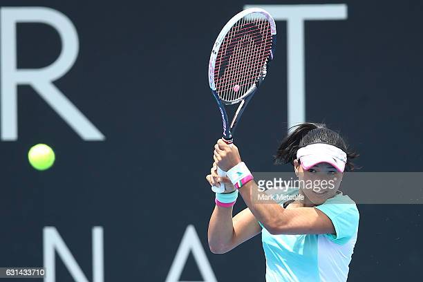 Risa Ozaki of Japan plays a backhand in her second round match against Lucie Safarova of Czech Republic during day two of the 2017 Hobart...
