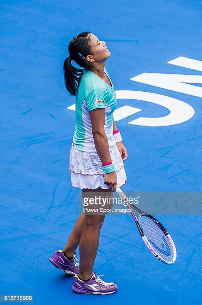 Risa Ozaki of Japan reacts after loosing a point against Venus Williams of USA during their Singles Round 1 match of the Prudential Hong Kong Open at...