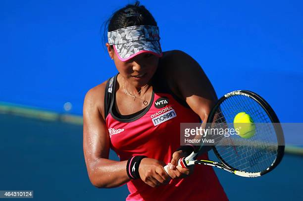 Risa Ozaki of Japan returns a shot against Louisa Chirico of USA during a female single match as part of Telcel Mexican Open 2015 at Mextenis Stadium...