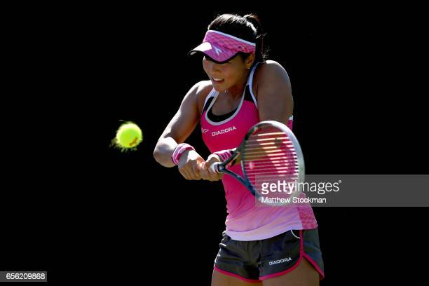 Risa Ozaki of Japan returns a shot to Julia Boserup during the Miami Open at the Crandon Park Tennis Center on March 21 2017 in Key Biscayne Florida