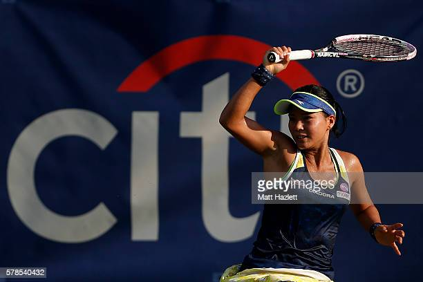 Risa Ozaki of Japan returns a shot to Naomi Broady of Great Britain during day 4 of the Citi Open at Rock Creek Tennis Center on July 21 2016 in...