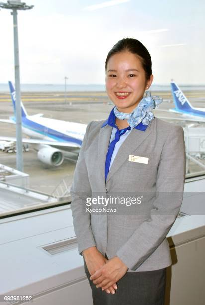 Risa Seike who joined All Nippon Airways Co as an cabin attendant after taking courses at its Airline School poses for a photo at Haneda airport in...