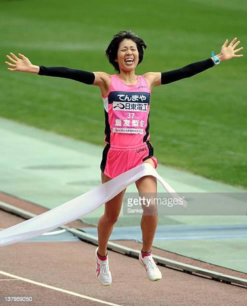 Risa Shigetomo crosses the finishing line to win the 31st Osaka International Women's Marathon at Nagai Stadium on January 29, 2012 in Osaka, Japan.
