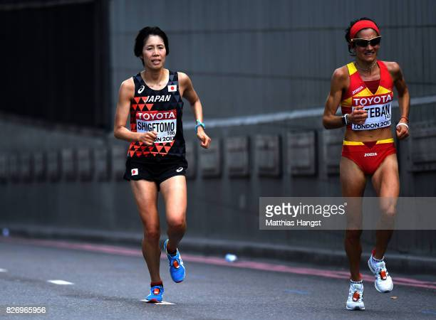 Risa Shigetomo of Japan and Marta Esteban of Spain compete during the Women's Marathon on day three of the 16th IAAF World Athletics Championships...