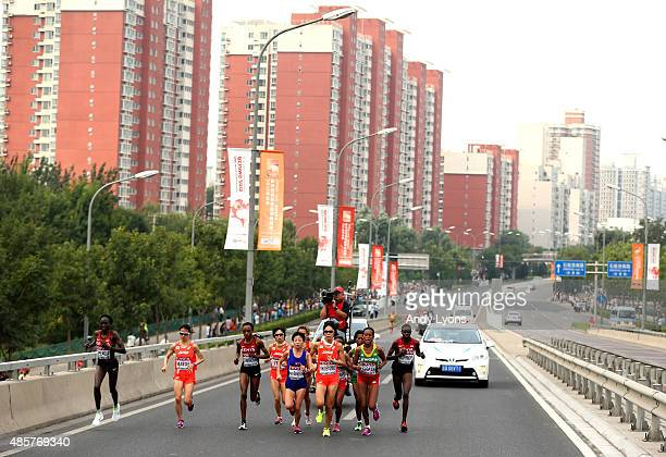 Risa Shigetomo of Japan, Hye-Song Kim of North Korea and Tirfi Tsegaye of Ethiopia lead the field during the Women's Marathon on day nine of the 15th...