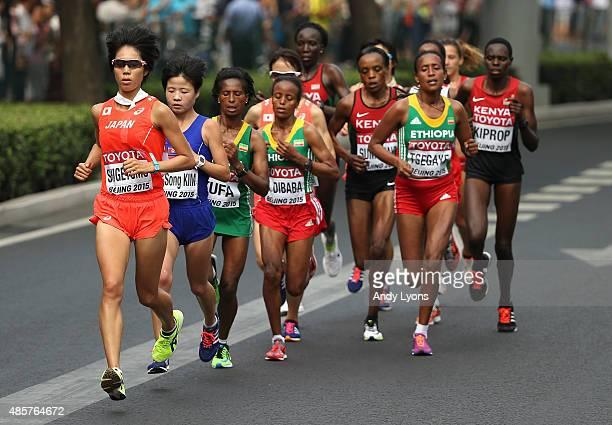 Risa Shigetomo of Japan, Hye-Song Kim of North Korea, Tigist Tufa of Ethiopia and Mare Dibaba of Ethiopia lead the field during the Women's Marathon...