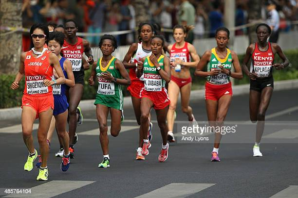 Risa Shigetomo of Japan, Tigist Tufa of Ethiopia and Mare Dibaba of Ethiopia lead the field during the Women's Marathon on day nine of the 15th IAAF...