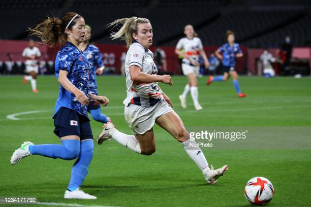 Risa SHIMIZU of Team Japan is challenged by Lauren HEMP of Team Great Britain during the Women's First Round Group E match between Japan and Great...