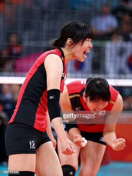 Risa Shinnabe and Erika Araki of Japan celebrate after a point against Korea during the Women's Volleyball on Day 15 of the London 2012 Olympic Games...