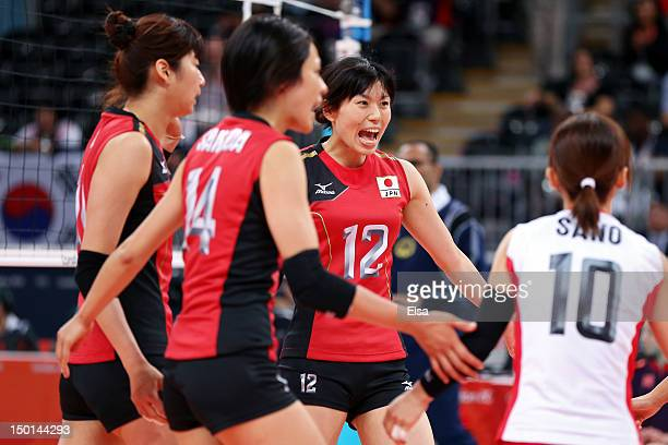 Risa Shinnabe of Japan celebrates with her team after a point against Korea during the Women's Volleyball on Day 15 of the London 2012 Olympic Games...
