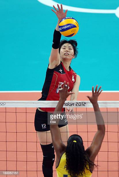 Risa Shinnabe of Japan spikes the ball as Fernanda Rodrigues of Brazil defends during the Women's Volleyball semifinal match on Day 13 of the London...