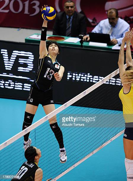 Risa Shinnabe of Japan spikes the ball during day two of the FIVB World Grand Prix Sapporo 2013 match between Japan and Brazil at Hokkaido...