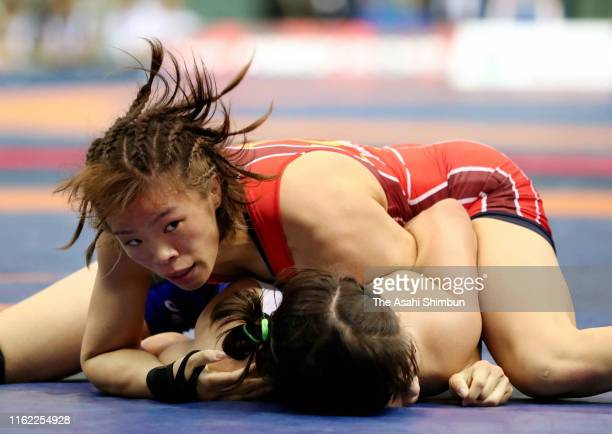 Risako Kawai and Sae Nanjo compete in the Women's 57kg 2nd round on day three of the All Japan Wrestling Invitational Championships at Komazawa...