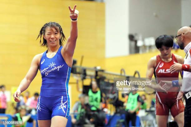 Risako Kawai celebrates her victoruy over Kaori Icho in the Women's 57kg playoff match during the Wrestling World Championships Japan Playoffs at...