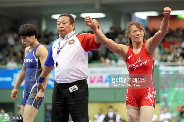 Risako Kawai celebrates while Kaori Icho shows dejection after the Women's 57kg final on day four of the All Japan Wrestling Invitational...