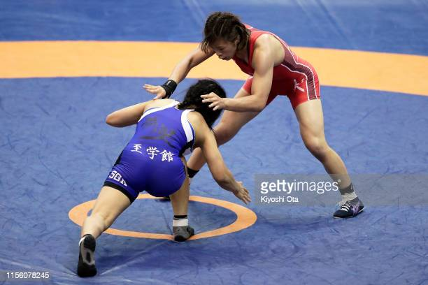 Risako Kawai competes against Akie Hanai in the Women's 57kg semifinal match on day three of the All Japan Wrestling Invitational Championships at...