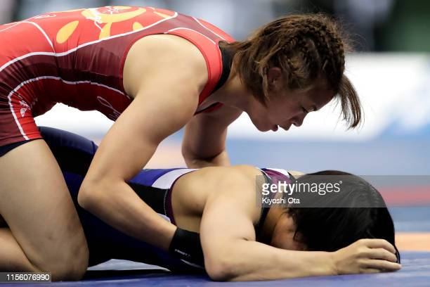 Risako Kawai competes against Hanako Sawa in the Women's 57kg match on day three of the All Japan Wrestling Invitational Championships at Komazawa...