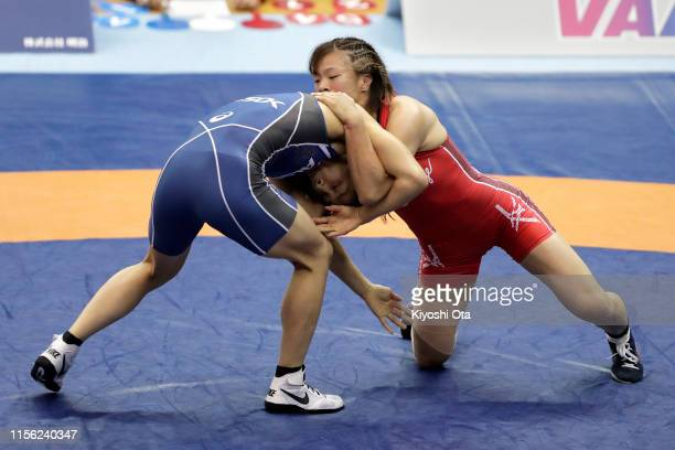 Risako Kawai competes against Kaori Icho in the Women's 57kg final match on day four of the All Japan Wrestling Invitational Championships at...