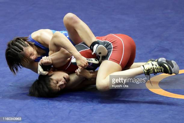 Risako Kawai competes against Kaori Icho in the Women's 57kg play-off match during the Wrestling World Championships Japan Play-offs at Wako Sports...