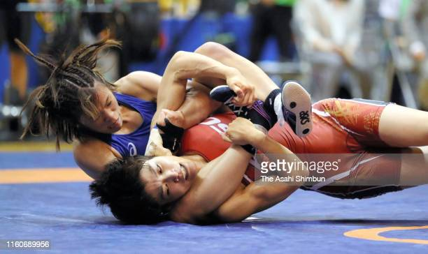 Risako Kawai competes against Kaori Icho in the Women's 57kg playoff match during the Wrestling World Championships Japan Playoffs at Wako Sports...