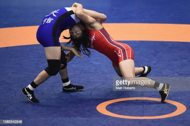 Risako Kawai competes against Sae Nanjo during the women's 57kg Freestyle match on day three of the Emperor's Cup All Japan Wrestling Championships...