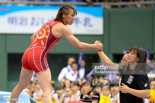 Risako Kawai is congratulated by the Women's 62kg gold medalist and her sister Yukako Kawai after beating Kaori Icho in the Women's 57kg final on day...