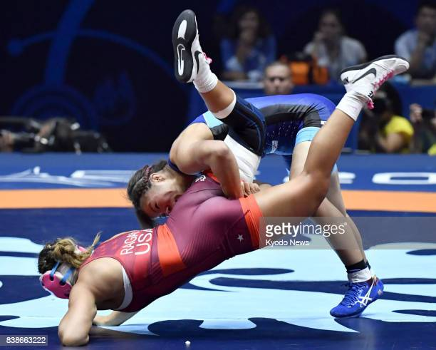 Risako Kawai of Japan and Allison Mackenzie Ragan of the United States compete in the women's 60kilogram final at the world wrestling championships...