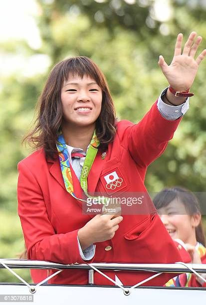 Risako Kawai waves on the top of a double decker bus during the Rio Olympic Paralympic 2016 Japanese medalist parade in the ginza district on October...
