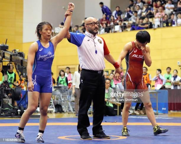 Risako Kawai wins over Kaori Icho in the Women's 57kg playoff match during the Wrestling World Championships Japan Playoffs at Wako Sports Gymnasium...