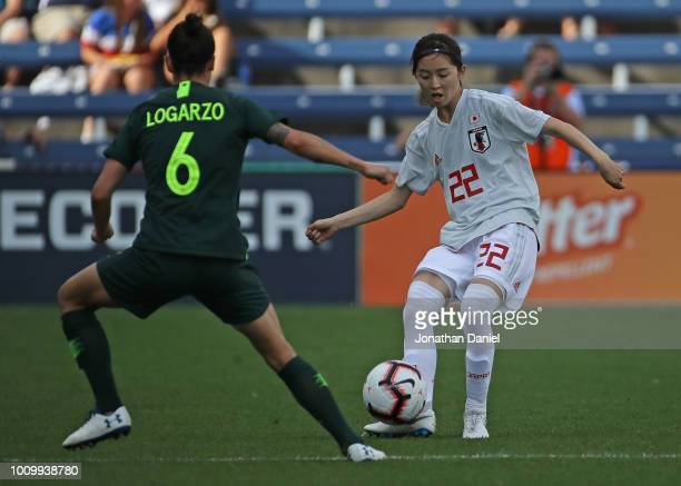 Rise Shimizu of Japan passes around Chloe Logarzo of Australia during the 2018 Tournament Of Nations at Toyota Park on August 2 2018 in Bridgeview...